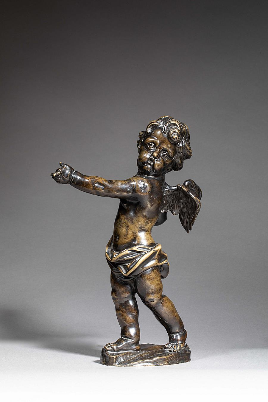 CIRCLE OF ROMBOUST VERHULST (1624-1698) - PUTTO HOLDING A PHYLACTERY