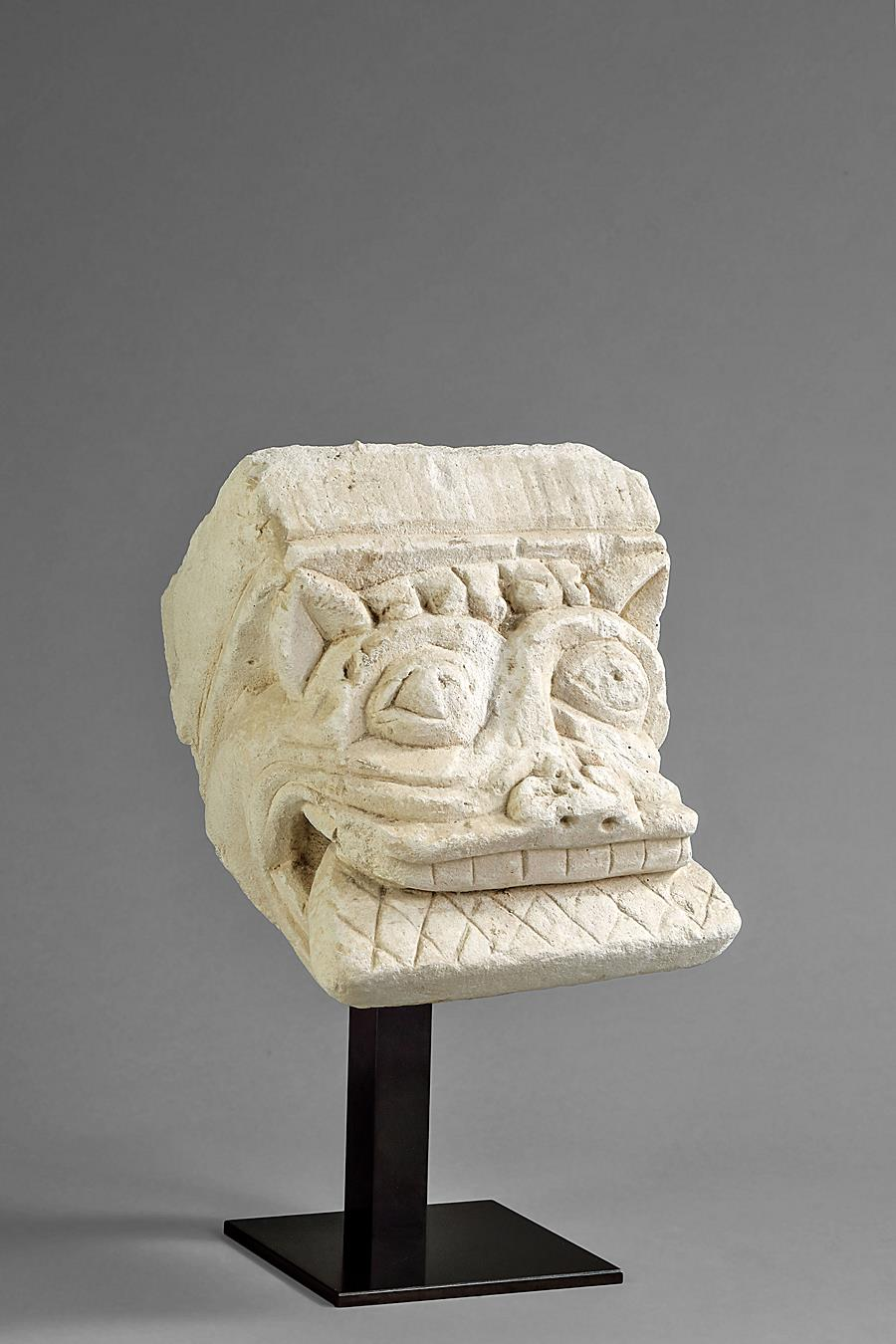 ROMANESQUE CORBEL WITH A MONSTER-LIKE HEAD