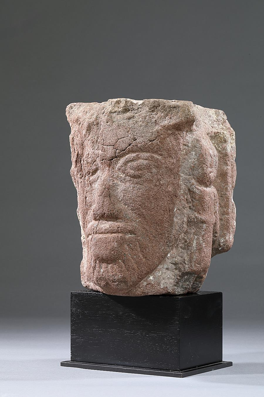 EARLY ROMANESQUE CORBEL  FROM STRASBOURG WITH HEAD OF A MAN AND TWO FIGURES