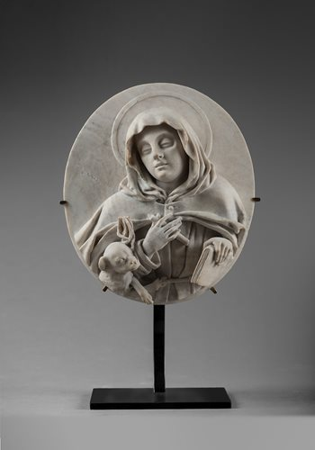 JOSEPH AND THE CHILD JESUS AND SAINT MARGARET OF CORTONA PAIR OF OVAL HIGH-RELIEF MEDALLIONS BOLOGNA EARLY 18 TH CENTURY