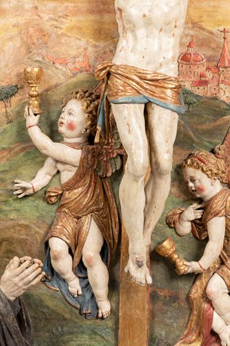 Follower of Hans Leinberger (v.1470-1531) Christ on the Cross with donator in adoration with Virgin Mary surrounded byfour angels