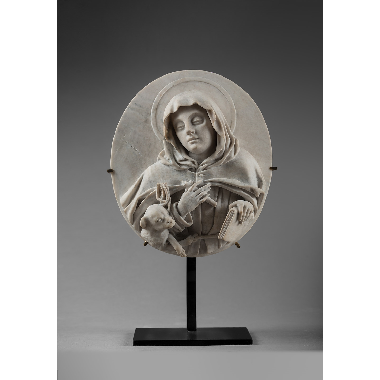 SAINT MARGARET OF CORTONA AND JOSEPH AND THE CHILD JESUS PAIR OF OVAL HIGH-RELIEF MEDALLIONS BOLOGNA EARLY 18 TH CENTURY